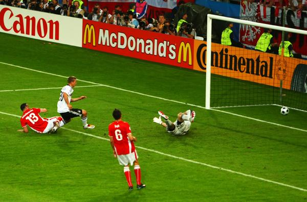 Germany's Lukas Podolski puts the opening goal in the back of the net.