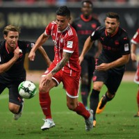 Bayern Munich's midfielder James Rodriguez (2nd L) and Arsenal defender Nacho Monreal (L) vie for the ball during the International Champions Cup football match between Bayern Munich and Arsenal in Shanghai on July 19, 2017.  / AFP PHOTO / Johannes EISELEJOHANNES EISELE/AFP/Getty Images